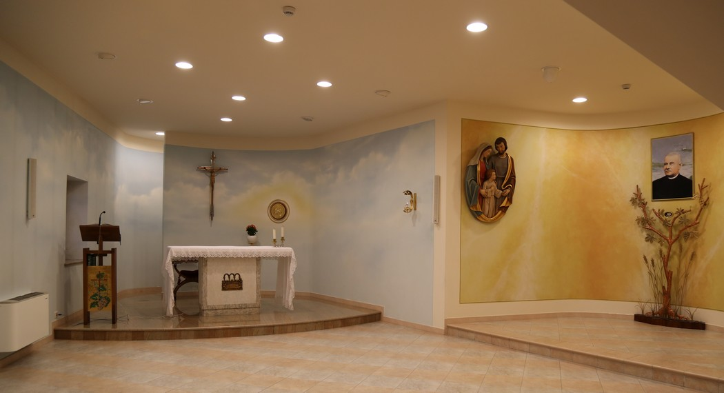 The throbbing center of the complex is the chapel in which one enters to praise God and goes forth  to serve  one's  brothers and sisters.